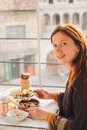 Woman taste turkish food from meatball and pottery kebab Royalty Free Stock Photo