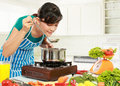 Woman is tasting her cooking Royalty Free Stock Photos