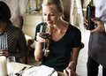 Woman Tasting Red Wine in a Classy Restaurant Royalty Free Stock Photo