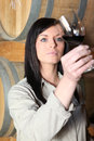 Woman tasting wine Royalty Free Stock Photography