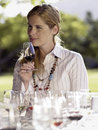 Woman tasting wine Stock Photo