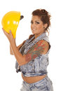 Woman tattoos construction hold hat look a in denim with a yellow hard and Stock Image