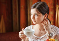 Woman with a tea mug in cafe Royalty Free Stock Photo