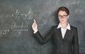 Woman teacher teaching maths
