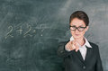 Woman teacher teaching maths and pointing on someone in glasses Royalty Free Stock Photos