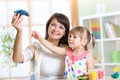 Woman teaches child handcraft at kindergarten or Royalty Free Stock Photo