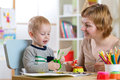 Woman teaches child handcraft Royalty Free Stock Photo