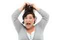 Woman tearing her hair out Stock Photo