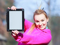 Woman teenage girl in pink tracksuit showing blank tablet outdoor fitness sport copy space screen of touchpad computer electronic Stock Images