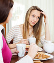 Woman telling to friend about her problems in home Stock Photography