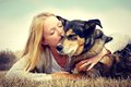 Woman Tenderly Hugging and Kissing Pet German Shep Royalty Free Stock Photo