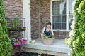 Woman tending to newly potted plants on her patio Royalty Free Stock Photo
