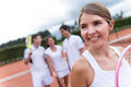 Woman at a tennis court the with looking happy Royalty Free Stock Images