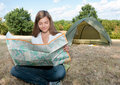 Woman tent camping map Stock Photography