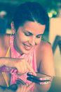 Woman texting on a mobile happy smiling and Royalty Free Stock Images