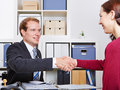 Woman thanking her financial adviser after a consultation in his office Stock Photo