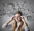 Woman thinking really hard with lots of things and toughs in mind Royalty Free Stock Photography