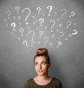 woman thinking with sketched question marks all over her head Royalty Free Stock Photo