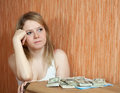 Woman thinks about the financial issue Stock Image