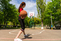 Woman Throwing Basketball from Top of Court Key Royalty Free Stock Photo