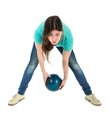 Woman is throwing a bowling ball at a simplistic way isolated over white Royalty Free Stock Photo