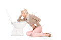 Woman throwing up in the toilet isolated on white background Royalty Free Stock Photography