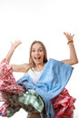 Woman throws a pile of clothes, isolated on white Royalty Free Stock Photo