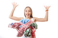 Woman throws a pile of clothes isolated on white background Royalty Free Stock Photography