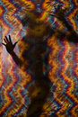 Woman and tie-dye cloth. Royalty Free Stock Photo