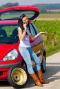 Woman with a tire in a car breakdown Royalty Free Stock Photo