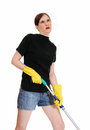 Woman tired of cleaning a young in shorts and yellow rubber cloves is floor s isolated for white background Royalty Free Stock Photography