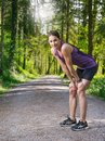 Woman tired and resting after jogging photo of a young her exercising Royalty Free Stock Photos