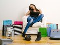 Woman tired from shopping photo of a beautiful in her early s resting a long day Stock Photo