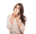 Woman with tissue catched a cold isolated on white Stock Photography