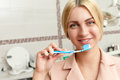 Woman with tooth brush Royalty Free Stock Photo