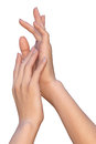 Woman touches to her soft and smooth hand a closeup of a female hands that are touching each other palm palm a a palm of with the Stock Photo