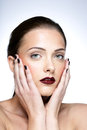 Woman touching her face beauty portrait of a cute Royalty Free Stock Image