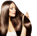 Woman touching her long hair beauty and healthy brown Stock Image
