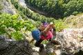 Woman tourist climbing a via ferrata route in Vadu Crisului, Apuseni mountains, Romania