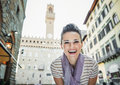 Woman tourist in the front of Palazzo Vecchio in Florence, Italy Royalty Free Stock Photo