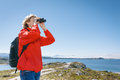 Woman tourist looking through binoculars Royalty Free Stock Photo