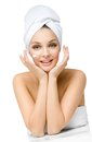 Woman with towel on head applies cream on face girl isolated white concept of healthcare beauty and youth Royalty Free Stock Image