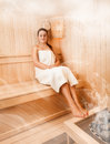 Woman in towel relaxing on bench at steamed sauna beautiful Royalty Free Stock Photography