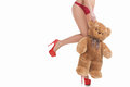 Woman with toy bear cropped image of in red panties holding while standing isolated on white Stock Photos