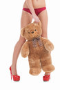 Woman with toy bear cropped image of young in red panties holding while standing isolated on white Royalty Free Stock Photos