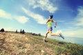 Woman trail runner running on beautiful mountain peak Royalty Free Stock Photo
