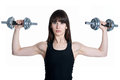 Woman trainer with dumbbells Stock Image