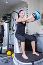 Woman on trainer machine in sport gym Stock Photos