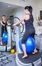 Woman on trainer machine in sport gym Royalty Free Stock Image