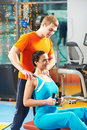Woman with trainer at training simulator Royalty Free Stock Photo